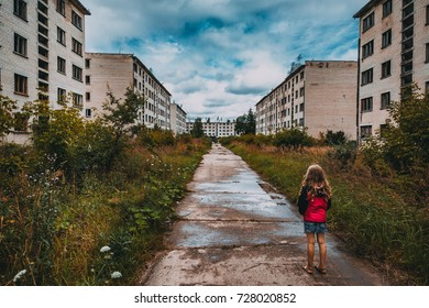 Lonely child in abandoned ghost town. End of the world theme. Ex Soviet legacy. World after nuclear disaster.
