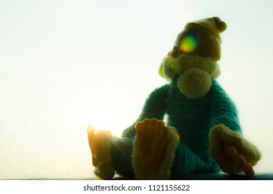 lonely clown sit near the window with len flare in high contrast concept