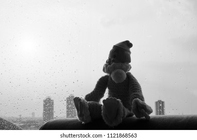 lonely clown sit near the window in black and white and high contrast concept
