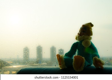 lonely clown sitting at the window and high contrast