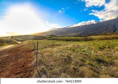 Lonely coastal road, sunset on Maui island, Hawaii