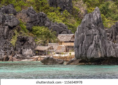 Lonely cottages between karst rocks in philippine sea