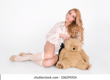 Lonely cute girl sit with lovely teddy bear