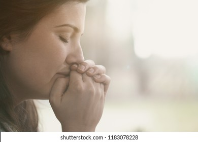 Lonely and depressed sad woman with hands on face