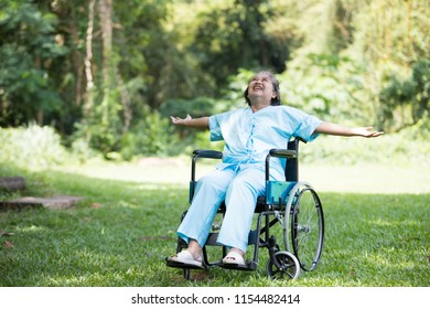 Lonely disabled woman sitting on  wheelchair