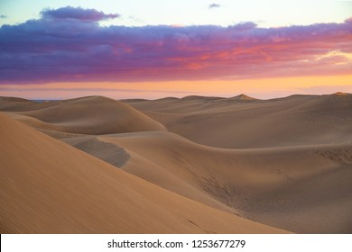 Lonely dusk scenery at famous dunes in Maspalomas, Gran Canaria, Spain