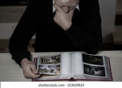 Lonely elderly man recollect happy memories from his life