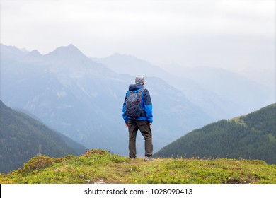 Lonely elderly tourist in the mountains