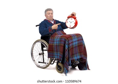 Lonely elderly in a wheelchair with big clock ticking...