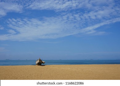 Lonely fisher boat on the sand of the beach of lome in Togo