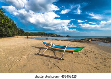 Lonely fishing boat at the Om beach in Gokarna, India
