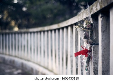 Lonely flower bouquet on a fence