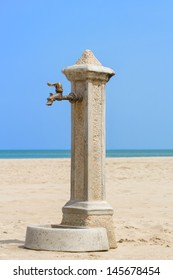 A lonely fountain on the italian beach.