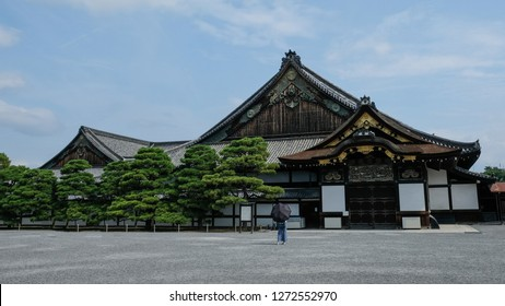 Lonely girl with black umbrella in front of Nijo Castle in Kyoto, Japan