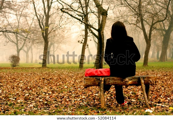 Lonely girl in the park