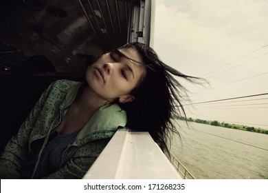 lonely girl rides on the train