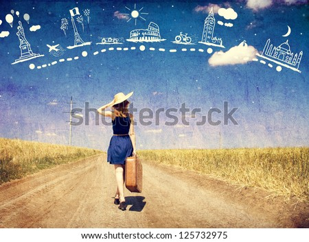 Lonely girl with suitcase
