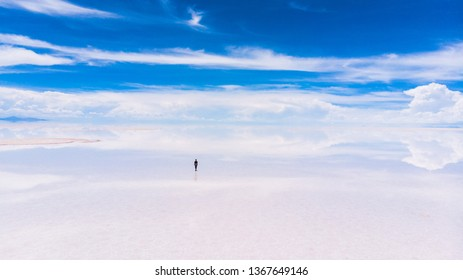 Lonely girl in the vast salt flats