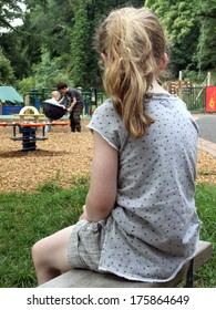 Lonely Girl watching other kids playing