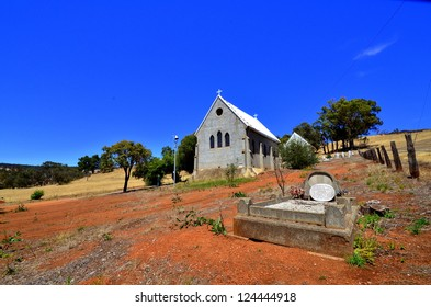 Lonely grave and old country church