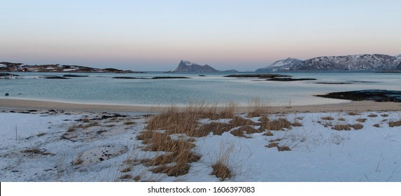 Lonely icy beach winter panorama