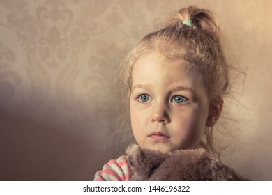 Lonely innocence scared child girl looking frightened with worried sight