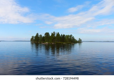 lonely island at lake inari in finland, europe
