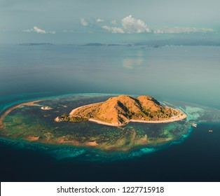 Lonely island, ocean. Aerial drone shot. Komodo. Stunning panoramic overview one of the amazing Komodo islands surrounded by the Pacific ocean. National Park. Indonesia. Beauty of wild virgin nature.