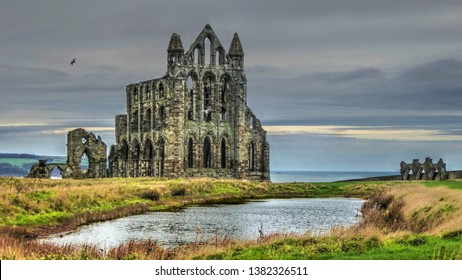 The lonely, isolated, iconic ruin of Whitby Abbey. Standing majestically, but mysteriously, on the cliff top above the North Sea, beneath a dark autumn sky.