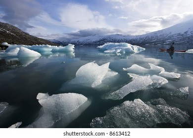 lonely kayak in glacier frost lake