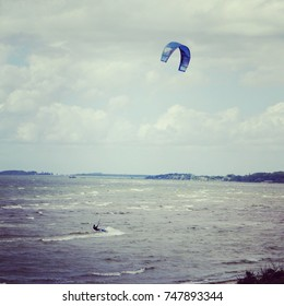 A lonely kite surfer surfing the waves of the sea Öresund between Sweden and Denmark.