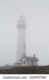 Lonely lighthouse in the fog, California