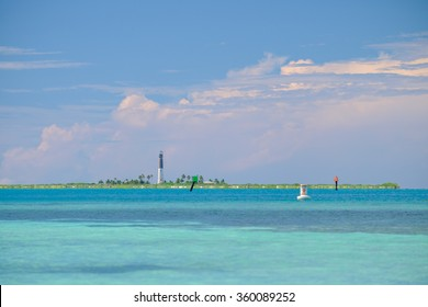The lonely Loggerhead Key Lighthouse sits on an island surround by the crystal clear and warm waters of the Gulf of Mexico off the Dry Tortugas