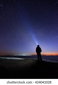 Lonely man at the beach under the stary sky