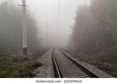 Lonely man in the fog goes by rail