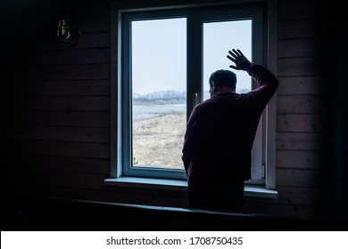 Lonely man at home by the window silhouette