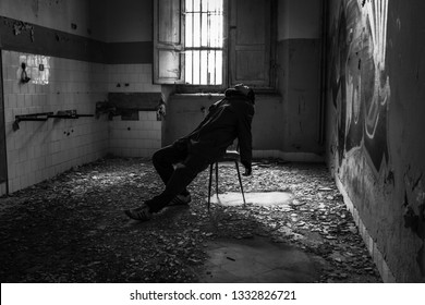 Lonely man inside Ferri pavillon, the judicial psychiatric hospital special area.  Abandoned asylum of Volterra (manicomio di Volterra), Tuscany, Italy 18/12/2011. This hospital was shut down in 1978.
