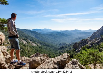 lonely man looking at the valley