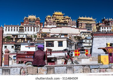 Lonely man sit in front of Songzanlin monastery/Tibet temple Style in China