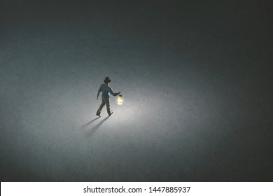 lonely man with torch light walking illuminating his path