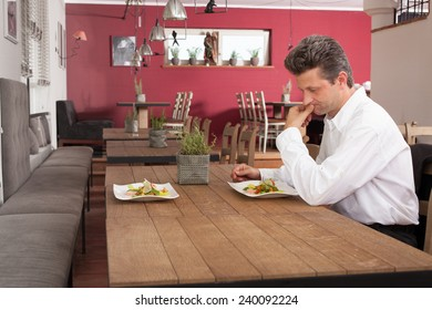 Lonely man waiting for dinner
