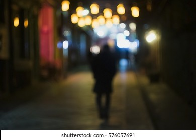 Lonely Man is Walking In A Shiny Street