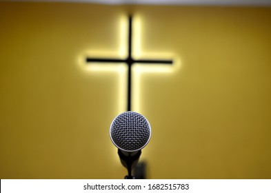 lonely microphone in front of the cross