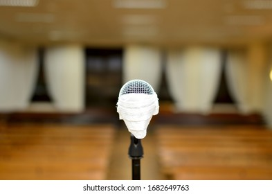 lonely microphone with mask in front of the empty room