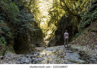 Lonely military tourist in Green canyon, New Athos, Abkhazia