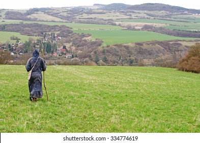lonely monk walking in nature. Man in fantasy larp  monk costume in nature.