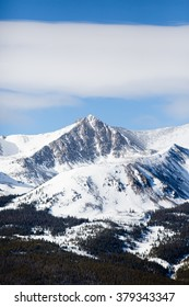 Lonely Mountain - This is an image of a beautiful snow covered mountain peak in Colorado.