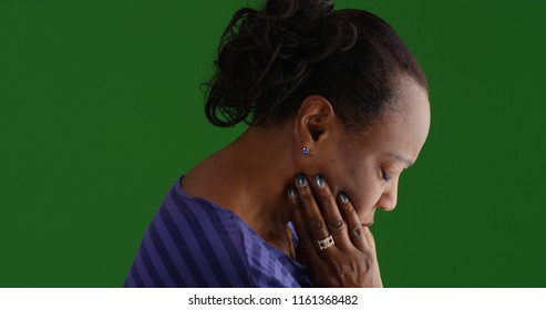 Lonely old black woman looking sad on green screen