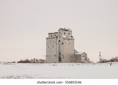 A lonely old grain elevator on the winter prairie.
