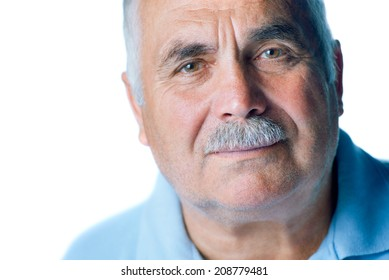 Lonely old man with gray hair and mustache up close on white background